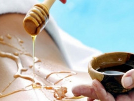 Medaus masažas su viso kūno įvyniojimu